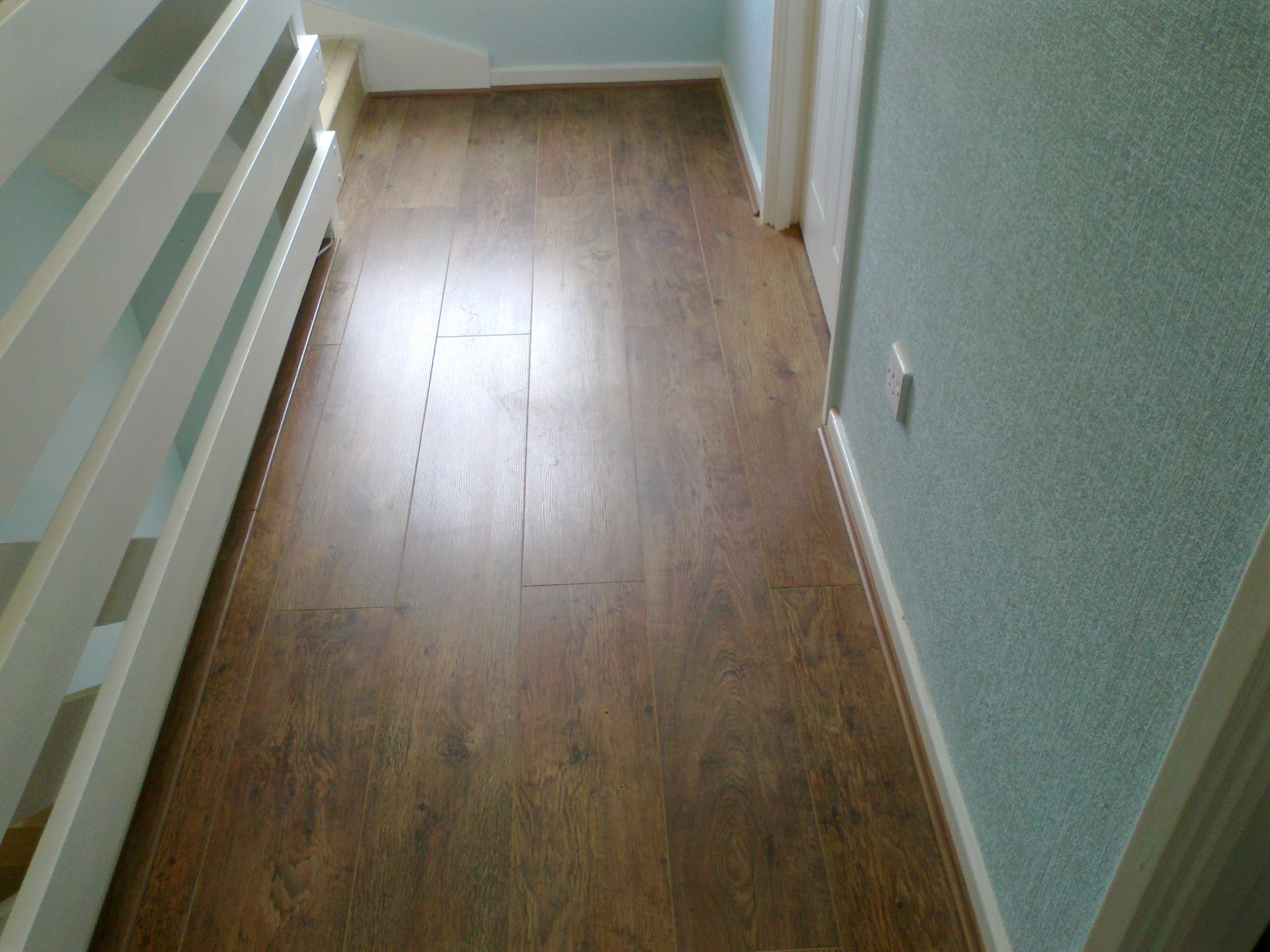 New laminate floors fitted in hackney step flooring ltd for Cheap flooring